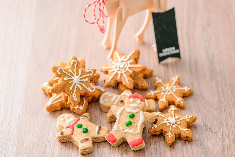 Christmas food. Gingerbread man and gingerbread star cookies in Christmas setting. Xmas dessert stock photo