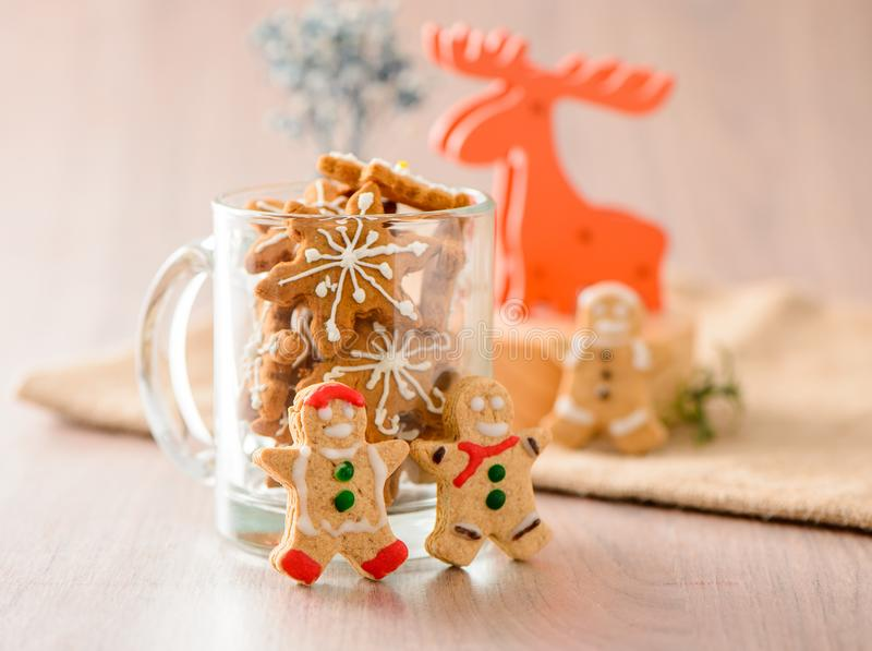 Christmas food. Gingerbread man and gingerbread star cookies in Christmas setting with elk. Xmas dessert stock image