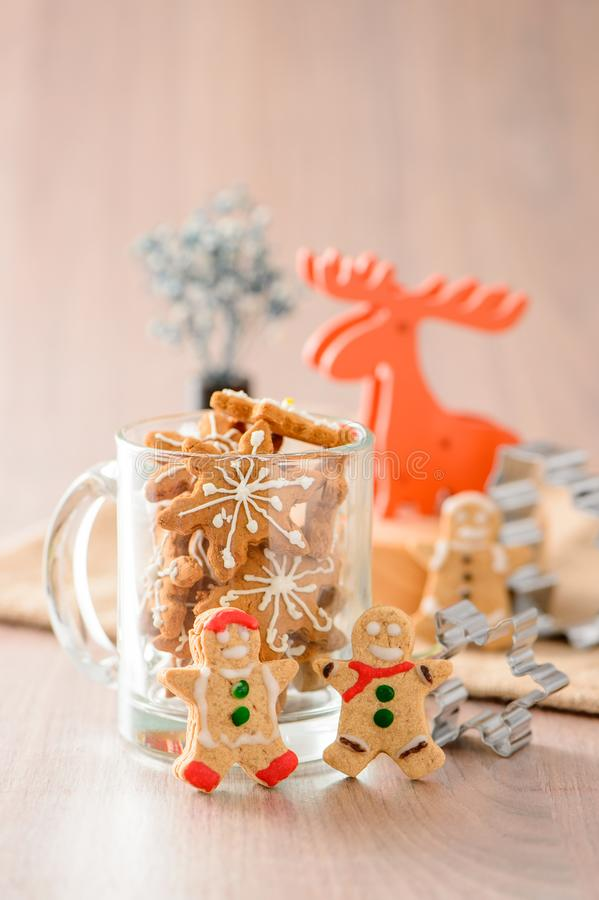 Christmas food. Gingerbread man and gingerbread star cookies in Christmas setting with elk. Xmas dessert royalty free stock photography
