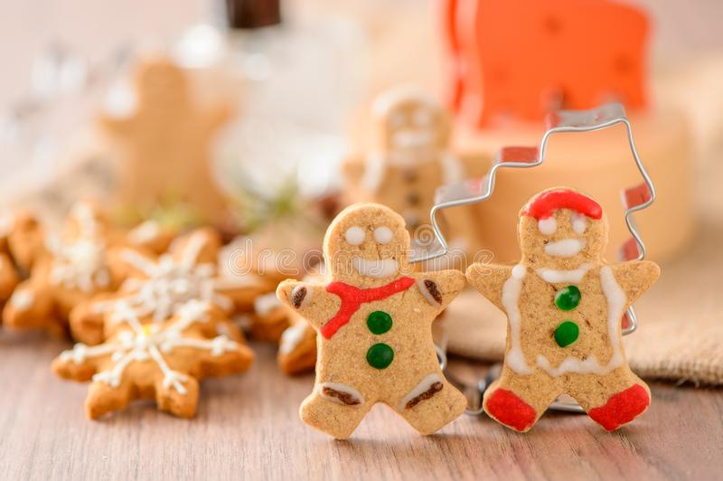 Christmas food. Gingerbread man and gingerbread star cookies in Christmas setting. Xmas dessert stock photos