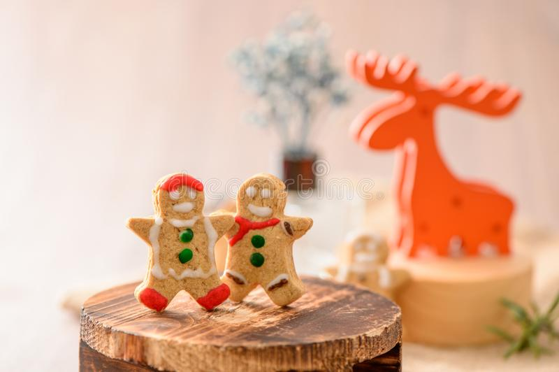 Christmas food. Gingerbread man and gingerbread star cookies in Christmas setting with elk. Xmas dessert stock photo