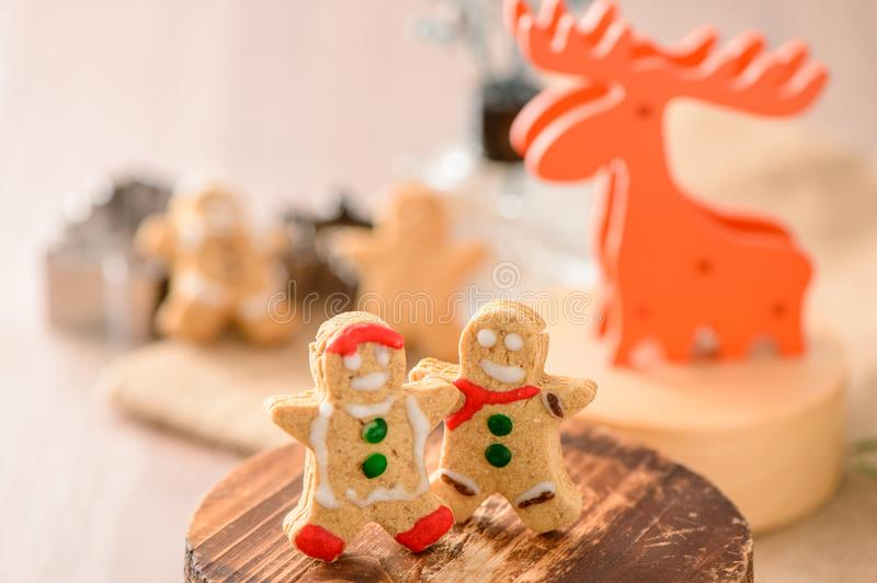 Christmas food. Gingerbread man and gingerbread star cookies in Christmas setting with elk. Xmas dessert royalty free stock photos