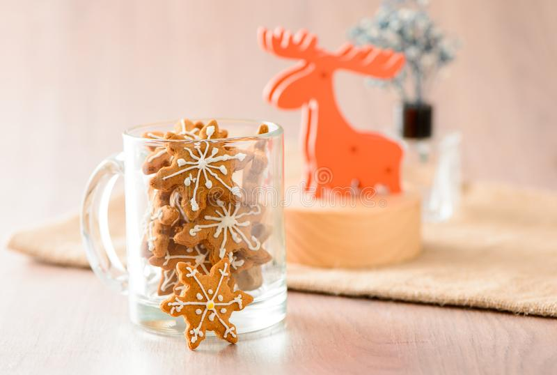 Christmas food. Gingerbread man and gingerbread star cookies in Christmas setting with elk. Xmas dessert stock photos