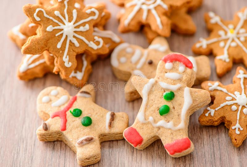 Christmas food. Gingerbread man and gingerbread star cookies in Christmas setting. Xmas dessert royalty free stock photography