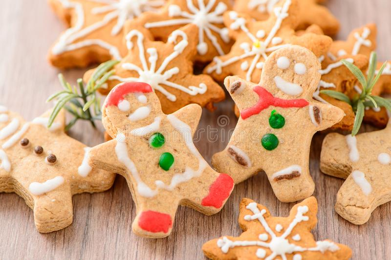 Christmas food. Gingerbread man and gingerbread star cookies in Christmas setting. Xmas dessert royalty free stock photo