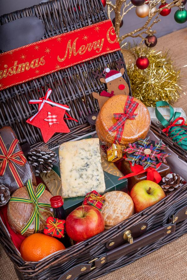 Christmas Food Hamper. Wicker Hamper loaded with Christmas Treats and Fruits stock photo