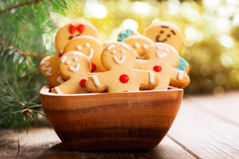 Christmas food.  Homemade gingerbread cookies in a bowl. On wooden table royalty free stock photos