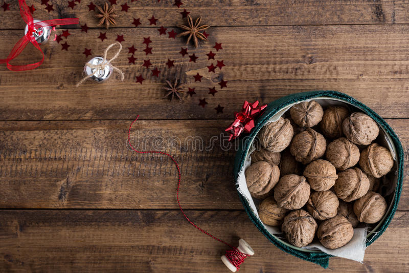 Christmas Food Scene with Walnuts and Decorations on Rustic Table stock image