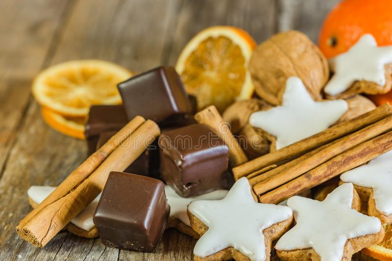 Christmas food, star biscuits, chocolate and spices on wooden table royalty free stock image