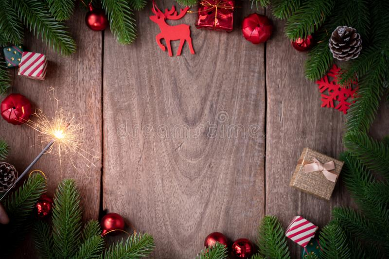 Christmas frame background with decorations and firework on wooden board royalty free stock photos