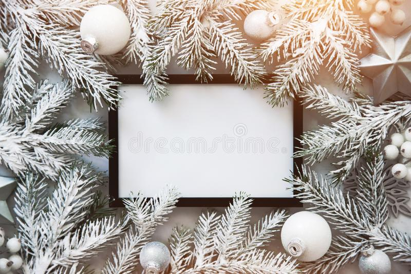 Christmas frame background with xmas tree and xmas decorations. Merry christmas greeting card, banner. Winter holiday theme. stock photos