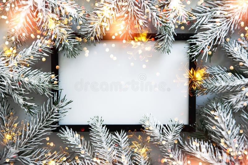Christmas frame background with xmas tree. Merry christmas greeting card, banner. Winter holiday theme. Happy New Year. Space for text. Flat lay stock images