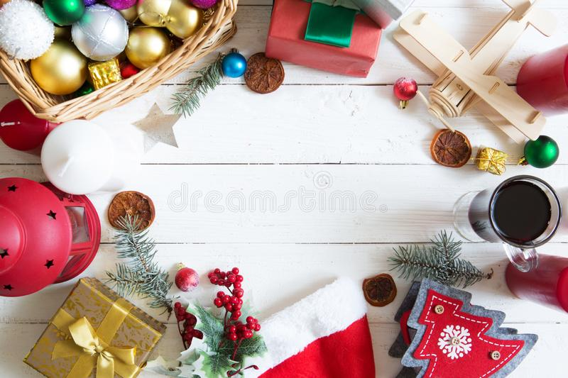 Christmas frame or border with a large assortment of christmas prop, decorations, balls, gifts and candles on a white wooden backg royalty free stock photography