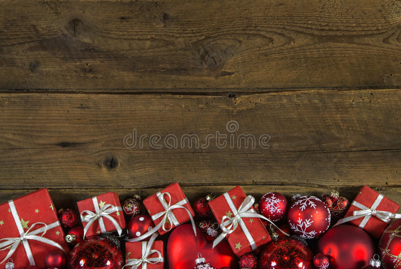 Christmas frame or border with red presents on wooden old background. royalty free stock photos
