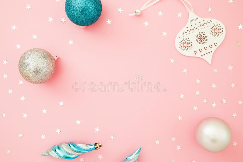 Christmas frame composition. Decoration and confetti on pastel pink background. Flat lay, top view. Holidays concept stock photos