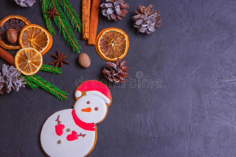 Christmas frame from fir tree branches and decorations on black background with space for text. Merry Christmas and Happy New Year. Xmas concept. Top view royalty free stock photos