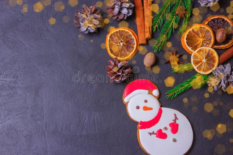 Christmas frame from fir tree branches and decorations on black background with space for text. Merry Christmas and Happy New Year. Xmas concept. Top view stock photo