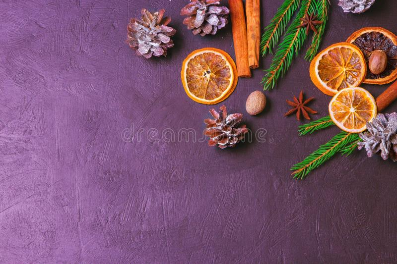 Christmas frame from fir tree branches and decorations on black background with space for text. Merry Christmas and Happy New Year. Xmas concept. Top view stock photography