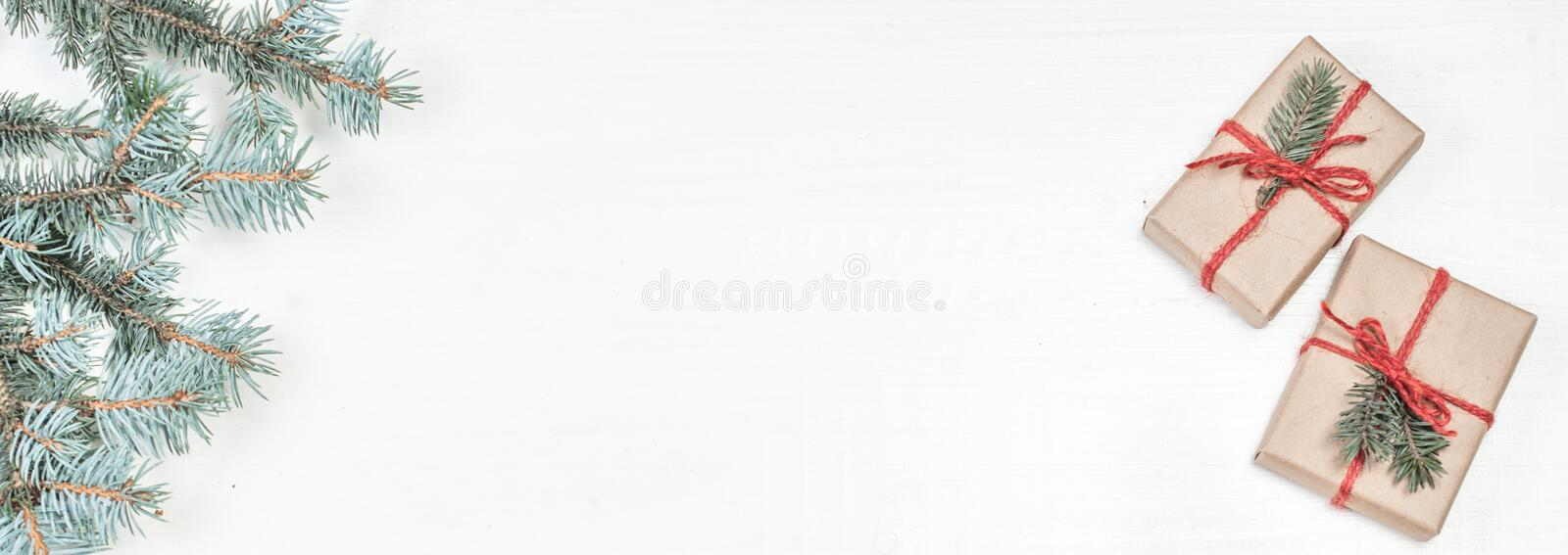 Christmas frame with Fir tree branches on white. Card Merry Christmas and Happy New Year with copy space.. royalty free stock photo