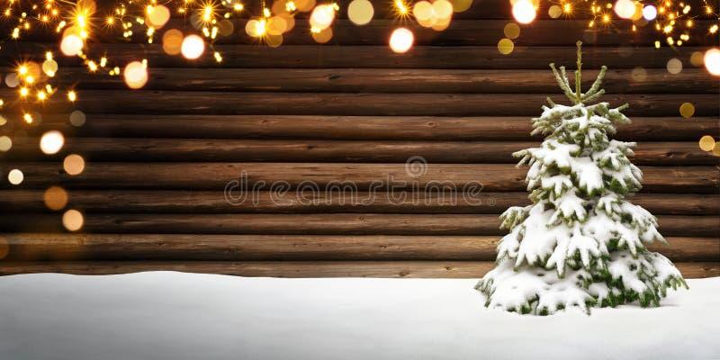 Christmas frame with fir tree, wood, snow and lights stock photo