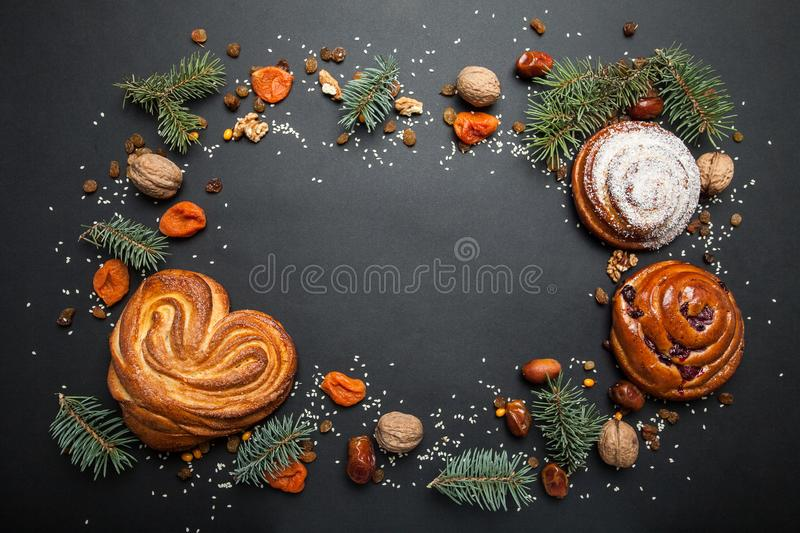 Christmas frame of fresh baked goods on a black background. Space for the text royalty free stock photos