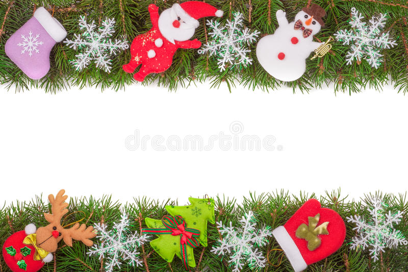 Christmas frame made of fir branches decorated with snowflakes Snowman and Santa Claus isolated on white background.  stock photo