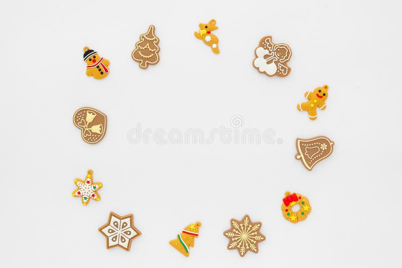 Christmas frame made of gingerbread cookies on white background. Christmas background. Christmas frame made of gingerbread cookies on white background. Creative stock images