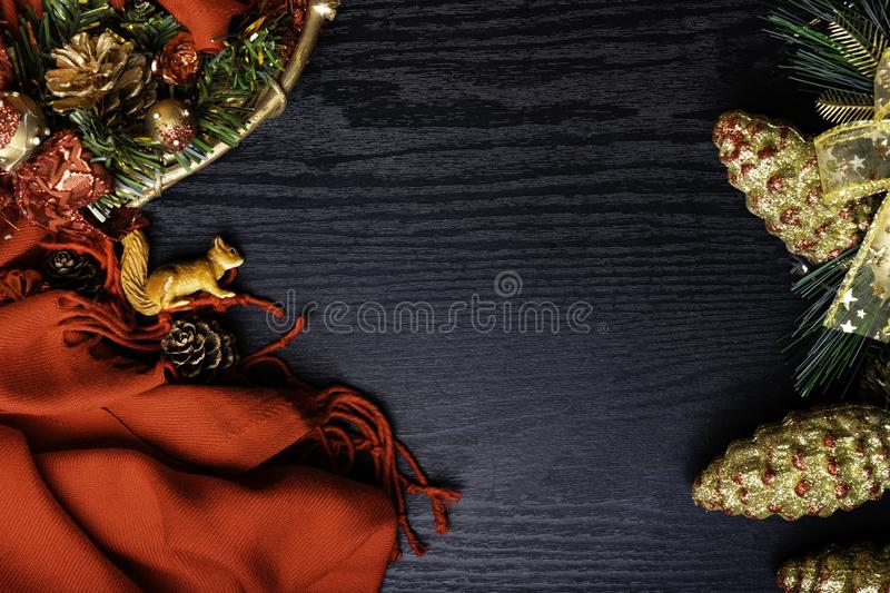 Christmas frame, red scarf, wreath, squirrel, bumps,on wooden background. Traditional rustic decor for new year holidays. Flat lay royalty free stock photography