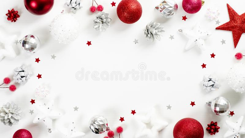 Christmas frame of red and silver decoration elements on white background top view. Xmas greeting card mockup, winter holidays royalty free stock image