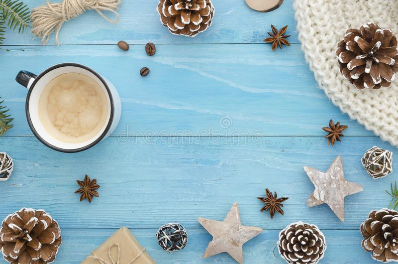 Christmas frame. Rustic blue wooden planks with anise star, pine cones and morning coffee. Winter,new year,Xmas Holiday. Christmas frame. Rustic blue wooden stock photos