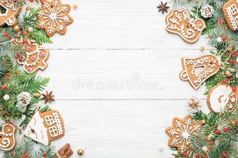 Christmas frame with rustic ornaments and Gingerbread cookies on royalty free stock photos