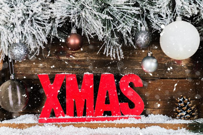 Christmas Frame from Snowy Fur tree branches, Wooden Xmas Letter royalty free stock photo
