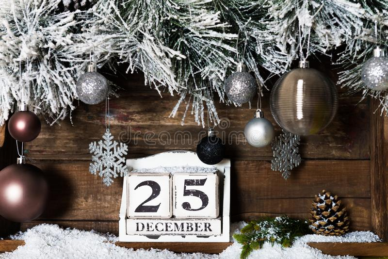 Christmas Frame from Snowy Xmas tree branches and Wooden Calenda royalty free stock image