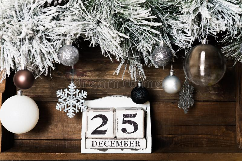 Christmas Frame from Snowy Xmas tree branches and Wooden Calenda royalty free stock photography