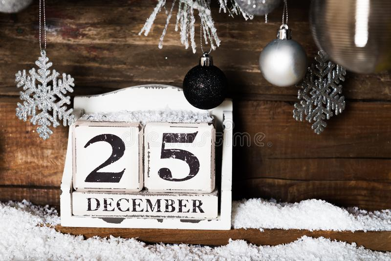 Christmas Frame from Snowy Xmas tree branches and Wooden Calenda royalty free stock photo