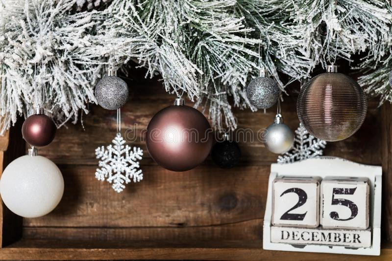 Christmas Frame from Snowy Xmas tree branches and Wooden Calenda stock images