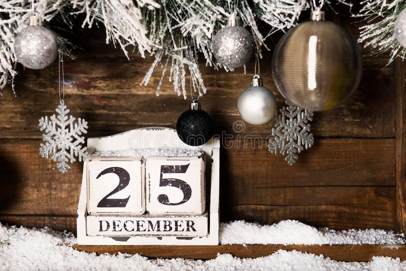 Christmas Frame from Snowy Xmas tree branches and Wooden Calenda stock photo
