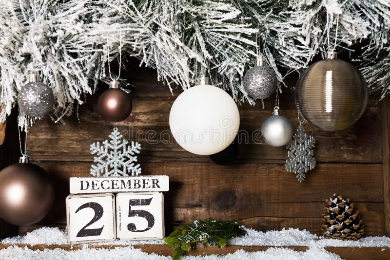 Christmas Frame from Snowy Xmas tree branches and Wooden Calenda stock photography