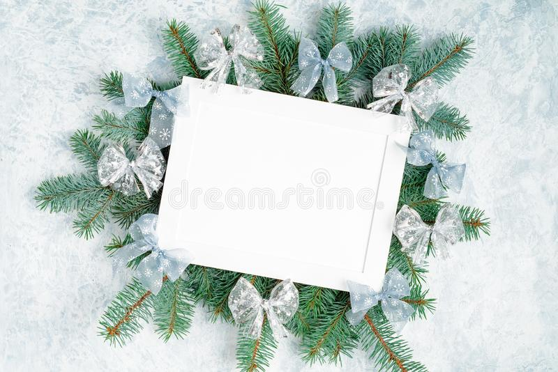 Christmas frame, surrounded by branches of a New Year tree Christmas decorations with copy space. Top view, flat lay stock images