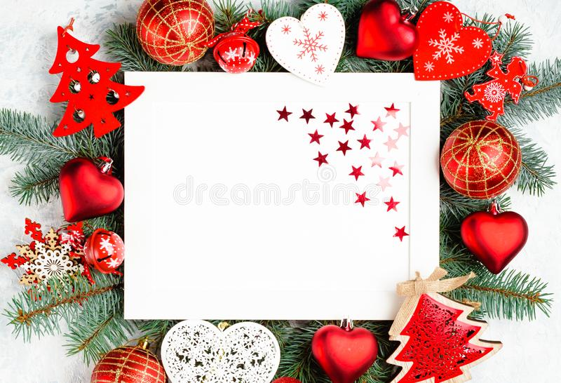 Christmas frame is surrounded by branches of a New Year tree Christmas decorations with copy space. Top view, flat lay royalty free stock images