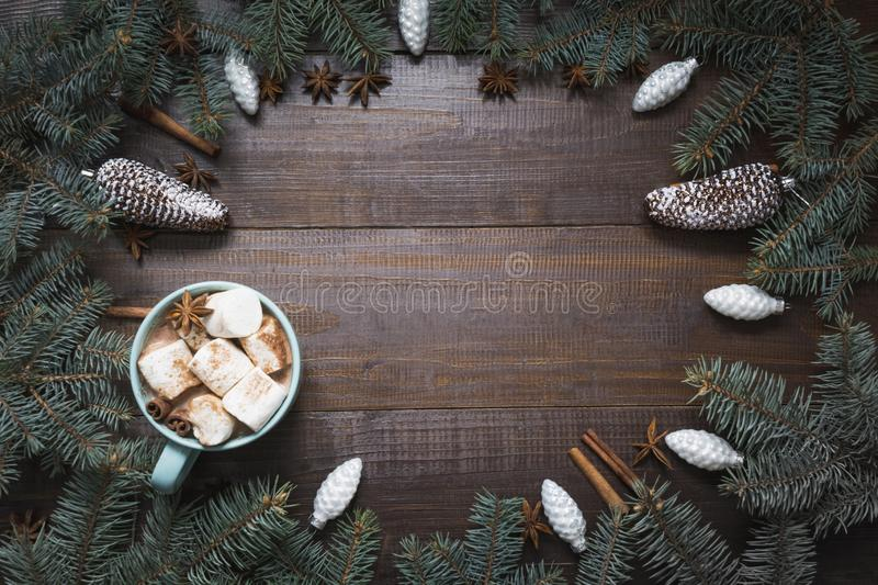 Christmas frame with white ornaments on wooden board. View from above. Holiday card. Space for text royalty free stock photos