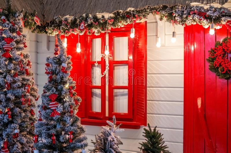 Christmas front door of a country house background. Decorated wi stock photo