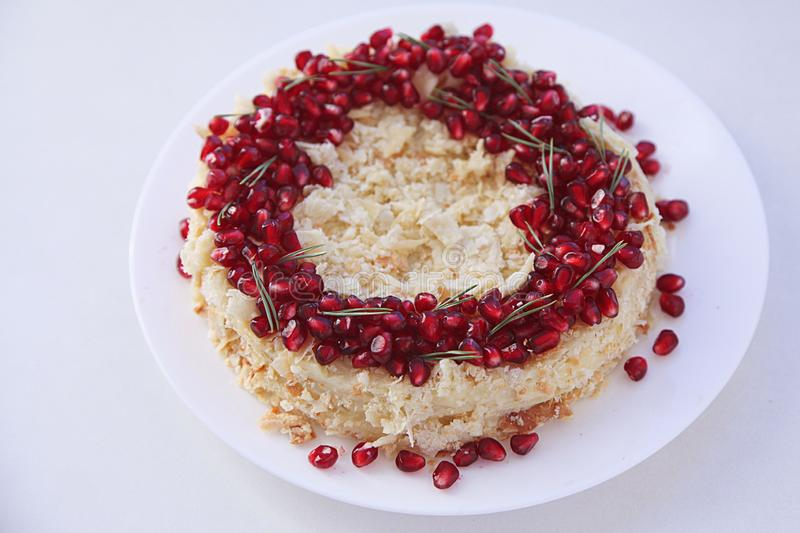 Christmas fruit cake, pudding on white plate. Traditional New Year dessert. stock photo