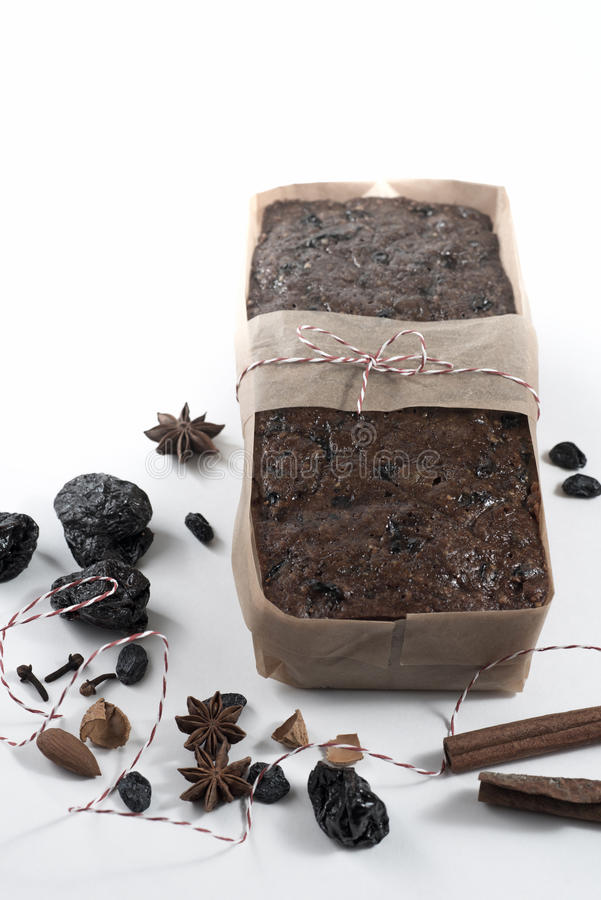 Christmas fruit loaf cake on paper royalty free stock photo