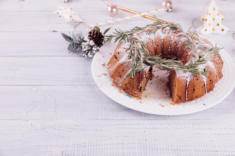 Christmas fruitcake on a white wooden table. stock images