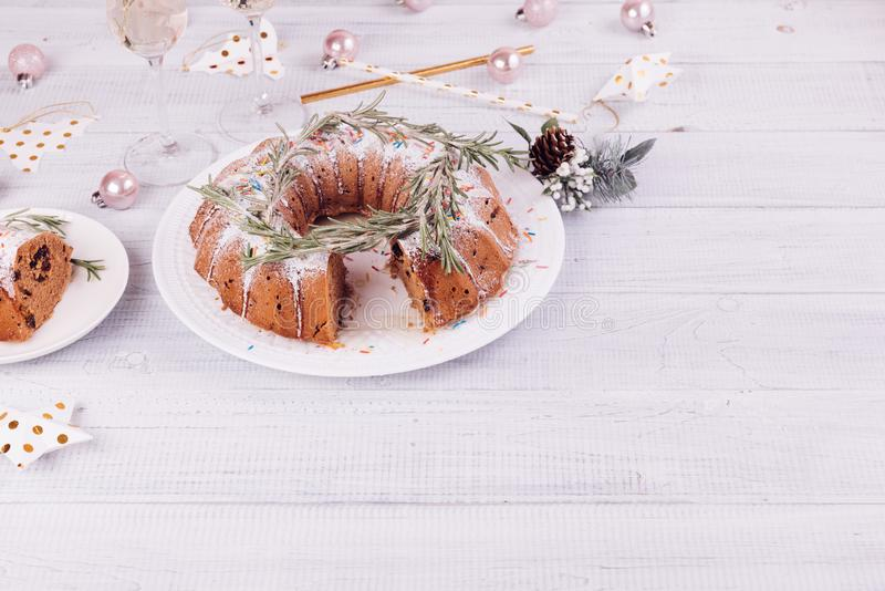 Christmas fruitcake on a white wooden table. royalty free stock images