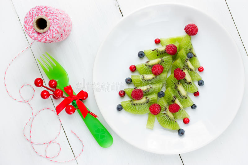 Christmas fun food idea for kids berry fruit Christmas tree for royalty free stock photography
