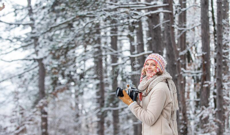 Christmas fun. woman use vintage camera. hobby time outdoor in winter day. admiring winter mountain landscape. Happy stock photos