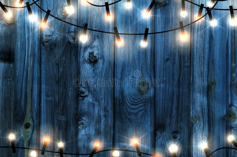 Christmas garland on blue wooden background stock images