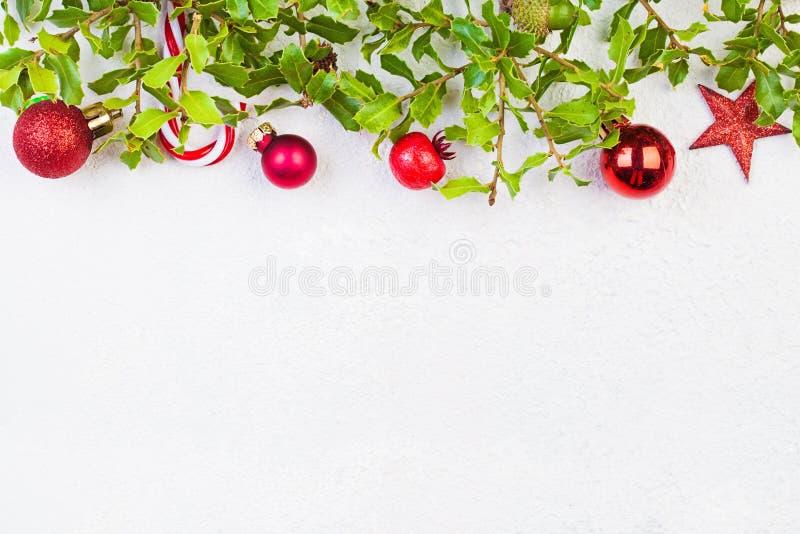 Christmas garland border on white plaster background.  stock photos